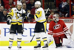 Penguins forwards Carl Hagelin and Nick Bonino celebrate Hagelin's second-period goal Friday at Carolina.