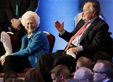 In this Feb. 25 file photo, former President George H. W. Bush, right, and his wife, Barbara, are greeted before a Republican presidential primary debate at The University of Houston in Houston.