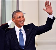 President Barak Obama waves to onlookers from the White House before the inauguration in January.