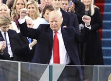 President Donald Trump pumps his fist after delivering his inaugural address after being sworn in as the 45th president of the United States on Friday.