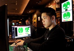 "Professional poker players Dong Kim, right, of Gardena, Calif., and Jason Les of Costa Mesa, Calif., play a hand of Heads-up no-limit Texas Hold'em Friday against a computer nicknamed Libratus. It's part of the ""Brains Vs. Artificial Intelligence"" poker tournament at Rivers Casino."
