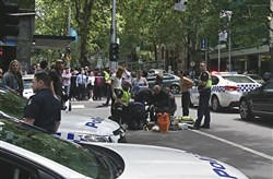 Police and emergency services gather at the scene after a  car careened into a group of pedestrians in the center of Melbourne, Australia, on Friday.