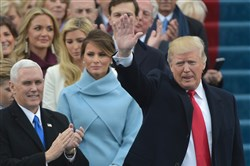 President Donald Trump waves to the crowd on the platform at the US Capitol in Washington, DC, Friday.