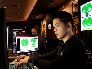 """Professional poker players Dong Kim, right, of Gardena, Calif., and Jason Les of Costa Mesa, Calif., play a hand of Heads-up no-limit Texas Hold'em Friday against a computer nicknamed Libratus. It's part of the """"Brains Vs. Artificial Intelligence"""" poker tournament at Rivers Casino."""