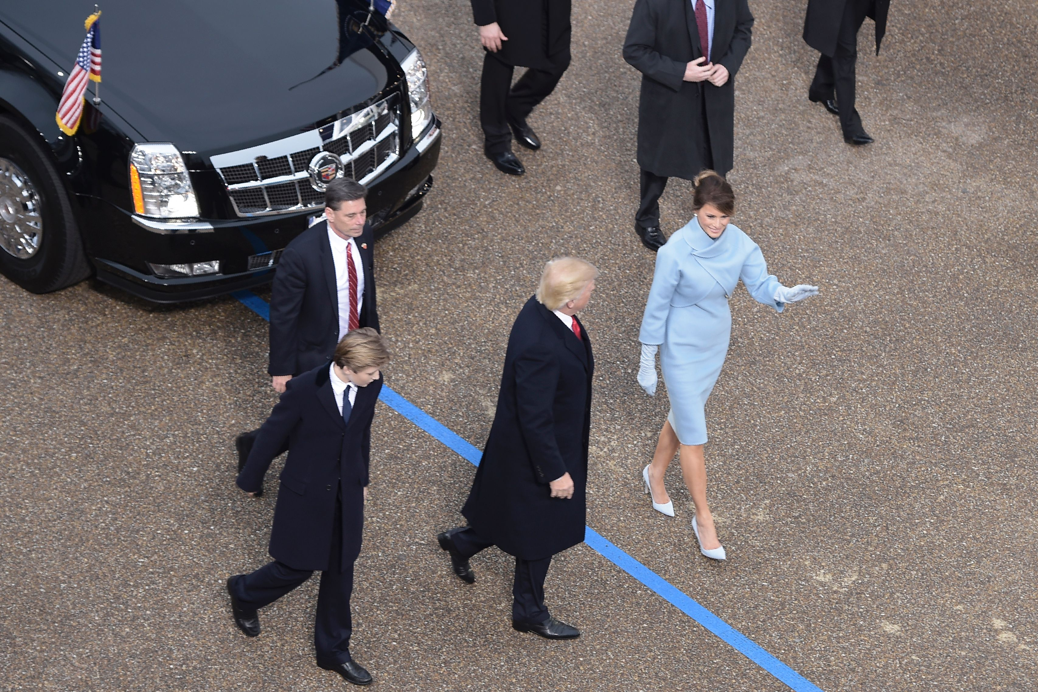 us-politics-INAUGURATION-PARADE-10 President Donald Trump walks out of the car with his son Barron and wife Melania surrounded by Secret Service officers at the White House as the presidential inaugural parade winds through the nation's capital Friday afternoon.