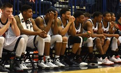 Duquesne's bench reacts near the end of their game against Rhode Island on Sunday. The Dukes lost, 90-69.