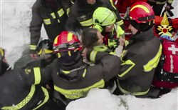 Italian firefighters extracting a woman alive Friday from under snow and debris of an hotel that was hit by an avalanche on Wednesday, in Rigopiano, central Italy.