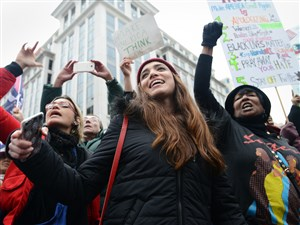 A crowd gathers for a rally in the middle of an intersection as marchers from the Women's March on Washington shut down numerous streets in Washington, D.C., on Saturday.
