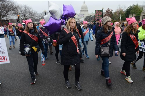 Women walk down Maryland Avenue as they arrive for the Women's March on Washington on Saturday.