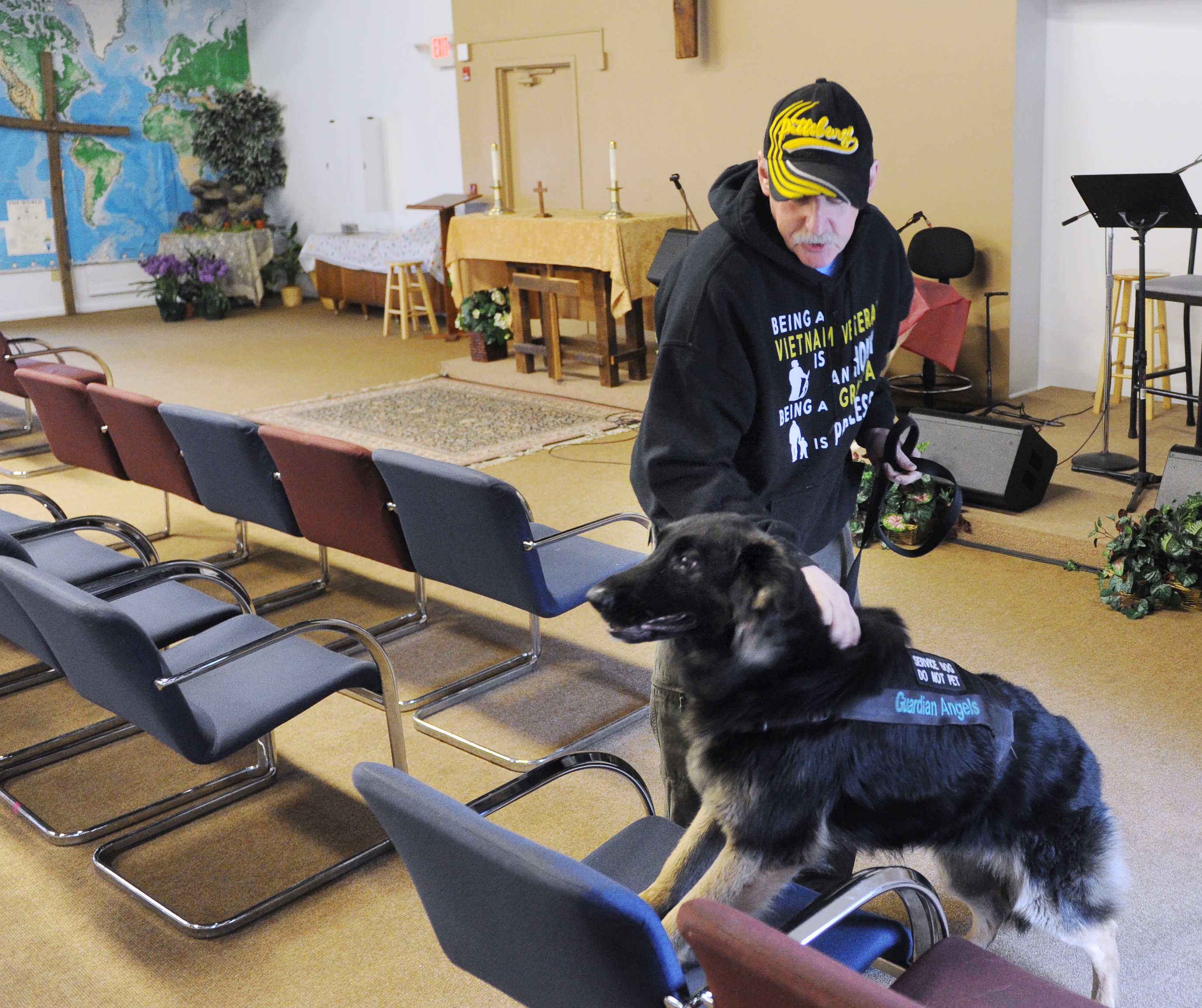 20170120ng-dog2-1 Bill Fennell of Carnegie works with Faith, a 4-year-old German shepherd during training at the Shepherd's Heart Veteran's Home in January 2017.