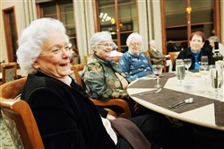"From left, Doreen Boyce, Constance Fischer, Nancy Courtney and Jane Reimers share a laugh after dinner at Longwood at Oakmont earlier this month. They are among the co-authors of ""Where's Laura?"""