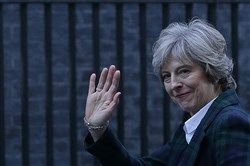 British Prime Minister Theresa May waves as she arrives back at 10 Downing Street in London on Tuesday.