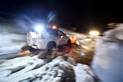 A volunteer clears the road with a snow plow Sunday in the village of Castelli, about 10 miles from the site where an avalanche engulfed the mountain hotel Rigopiano in Farindola in earthquake-ravaged central Italy.