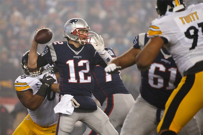 FOXBORO, MA - JANUARY 22: Tom Brady #12 of the New England Patriots looks to pass the ball during the first half against the Pittsburgh Steelers in the AFC Championship Game at Gillette Stadium on January 22, 2017 in Foxboro, Massachusetts. (Photo by Jim Rogash/Getty Images)