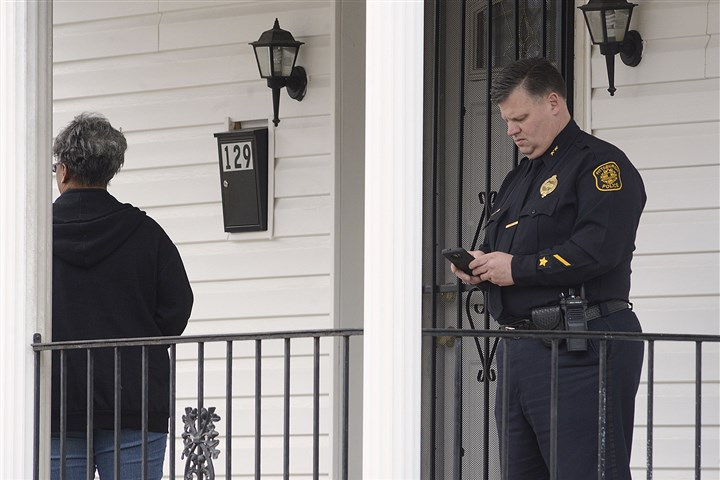 20170122lrlarimerkilling01 Acting Pittsburgh Police Chief Scott Schubert, right, gets ready to leave the porch at 129 Finley Street in Larimer.