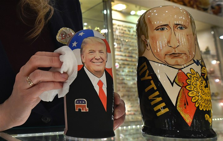 RUSSIA-US-POLITICS-2 An employee polishes traditional Russian wooden nesting dolls, Matryoshka dolls, depicting President Donald Trump and Russian President Vladimir Putin at a gift shop in central Moscow.
