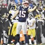 Patriots Chris Hogan signals a first down in front of Steelers Artie Burns in the first quarter of the AFC championship Sunday at Gillette Stadium Jan. 22.