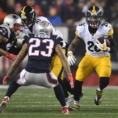 Le'Veon Bell picks up four yards against the Patriots.