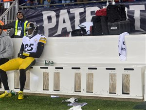 Steelers cornerback Artie Burns sits on the bench after losing to the Patriots in the AFC Championship Sunday at Gillette Stadium in Foxborough.