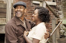 "Denzel Washington and Viola Davis during a scene from ""Fences."""