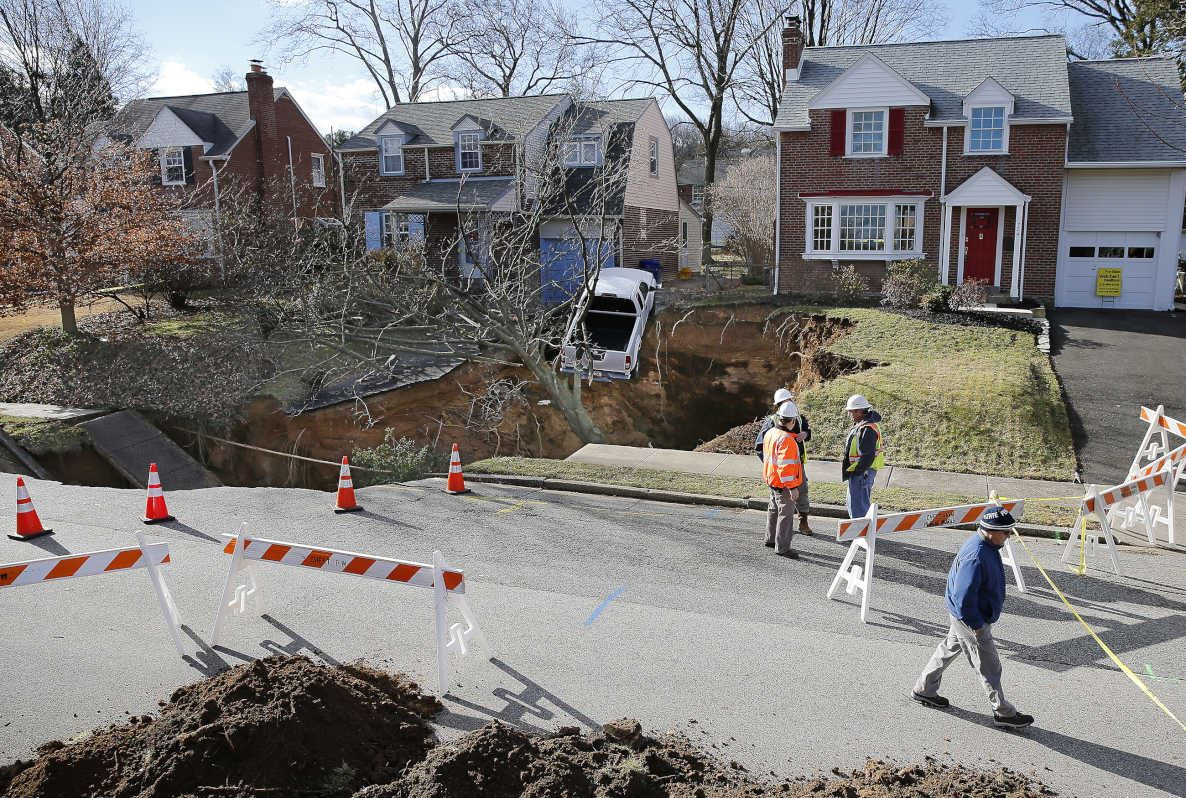 Sinkhole swallows yards, threatens pickup in Philadelphia suburb