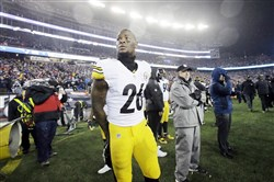 Le'Veon Bell watches part of the AFC championship from the sideline.
