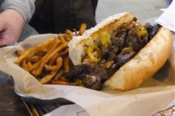 Pittsburgh Cheesesteak -- hanger steak, grilled onions/mushrooms, house-brined hot peppers,  Emerald Valley Artisans' Mozzarella, Mediterra Bakehouse's French  Baguette servied with hand-cut fries at the Railyard Grill & Tap Room in Bridgeville.