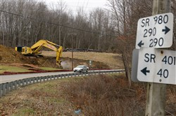 Crews from Independence Excavating in Cleveland begin the site clearing for the Southern Beltway along Route 980 near Quicksilver Road in McDonald.