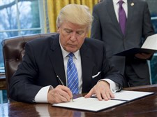President Donald Trump signs an executive order at the White House last month.
