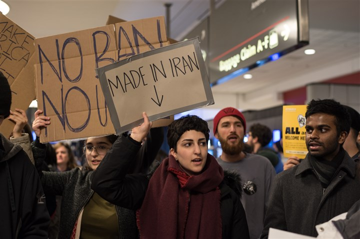Immigrant stories at Pittsburgh International Airport Mehrgol Tiv, 22, of Wexford was among those who protested President Donald Trump's travel ban at the baggage claim area at Pittsburgh International Airport on Sunday.