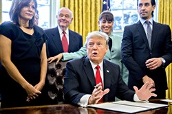 President Donald Trump speaks Monday before signing an executive order surrounded by small business leaders in the Oval Office.