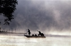 Fishermen try their hand as steam rises up from the Allegheny River  near Sharpsburg.