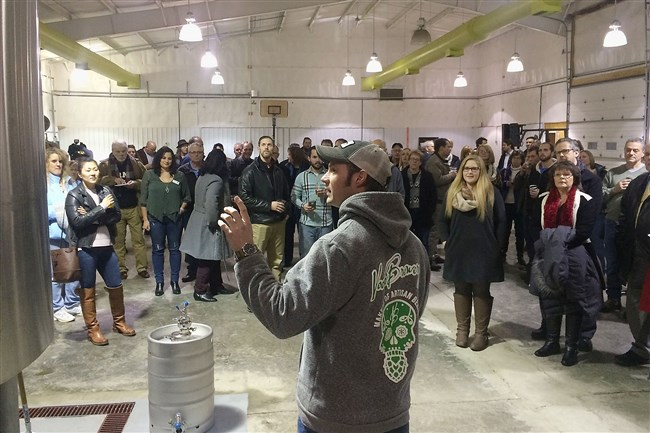 Shawn Strickland explains the brewing process to attendees of the opening of the new brewing facility of Voodoo Brewing Co. in Meadville.