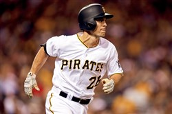 Adam Frazier records his first major league hit in the sixth inning during a game against the Los Angeles Dodgers at PNC Park.