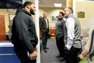 Pitt head coach Pat Narduzzi talks with former player Aaron Donald during national signing day Wednesday at the team's facility on the South Side.