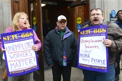 Randy Almond of Lincoln Place, right, and others protest about the unemployment compensation system during a rally outside the CareerLink Pittsburgh Building, Downtown in January.