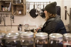 Kyra LeBlanc, operations manager of Zeke's Coffee in East Liberty, boils water Wednesday at the shop to use for washing dishes.