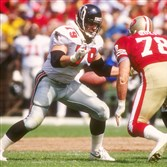 Offensive lineman Bill Fralic of the Atlanta Falcons prepares to block a San Francisco 49ers player during a game at Candlestick Park in San Francisco, California. Fralic, one of Pitt's all-time greats, spent his career playing for disappointing Falcons teams.