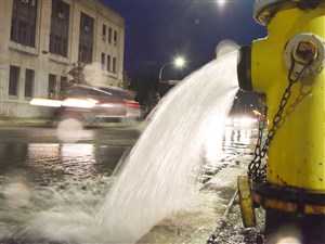 A hydrant runs onto North Euclid Avenue in East Liberty this month after PWSA issued its boil-water order.