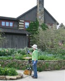 An artist paints plein air at the Southern Alleghenies Museum of Art at Ligonier Valley.