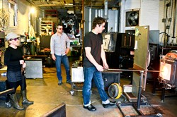 Drew Hine, right, of Vessel Studio makes a wine glass this month at the South Side studio as his wife, Jeannine, and Adam Kenney watch. Mr. Kenney is director of Craft Business Accelerator, which matches craftspeople and artisans in the Pittsburgh region with businesses and developers that can use their products.
