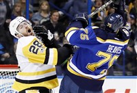 Ian Cole, left, reacts after being hit by St. Louis Blues' Ryan Reaves during a game in early February of this year.