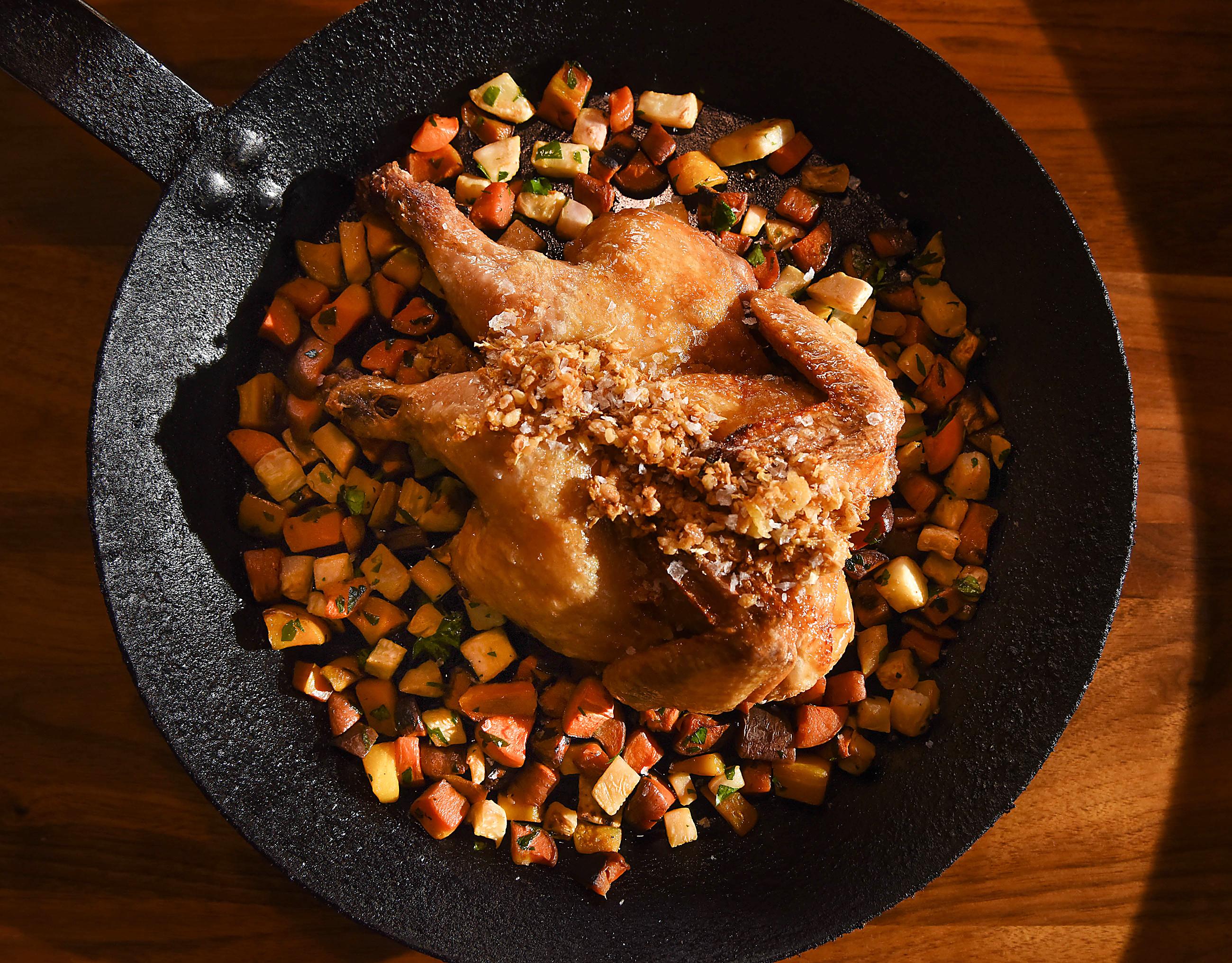 20170207smVivo-4-3 Crispy whole chicken with fried garlic at Vivo Kitchen in Sewickley.
