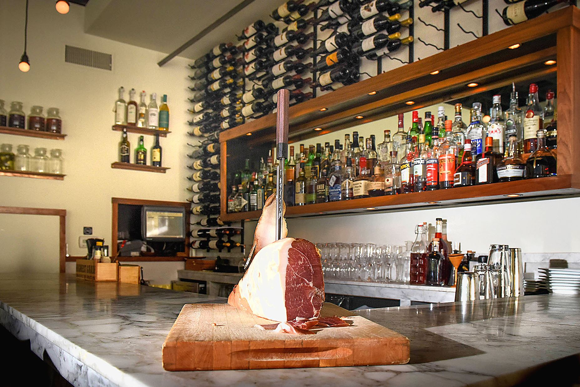 20170207smVivo-1 Marble top bar in front of the wine rack at Vivo Kitchen in Sewickley.