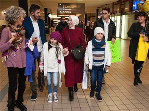 Case workers from Jewish Family and Children Services and friends walk with Syrian refugees Kholoud Alteara, 29, as she holds the hand of her son, Mohmad, and her daughter, Mays, 8, who arrived from Cairo to Pittsburgh International Airport in February.