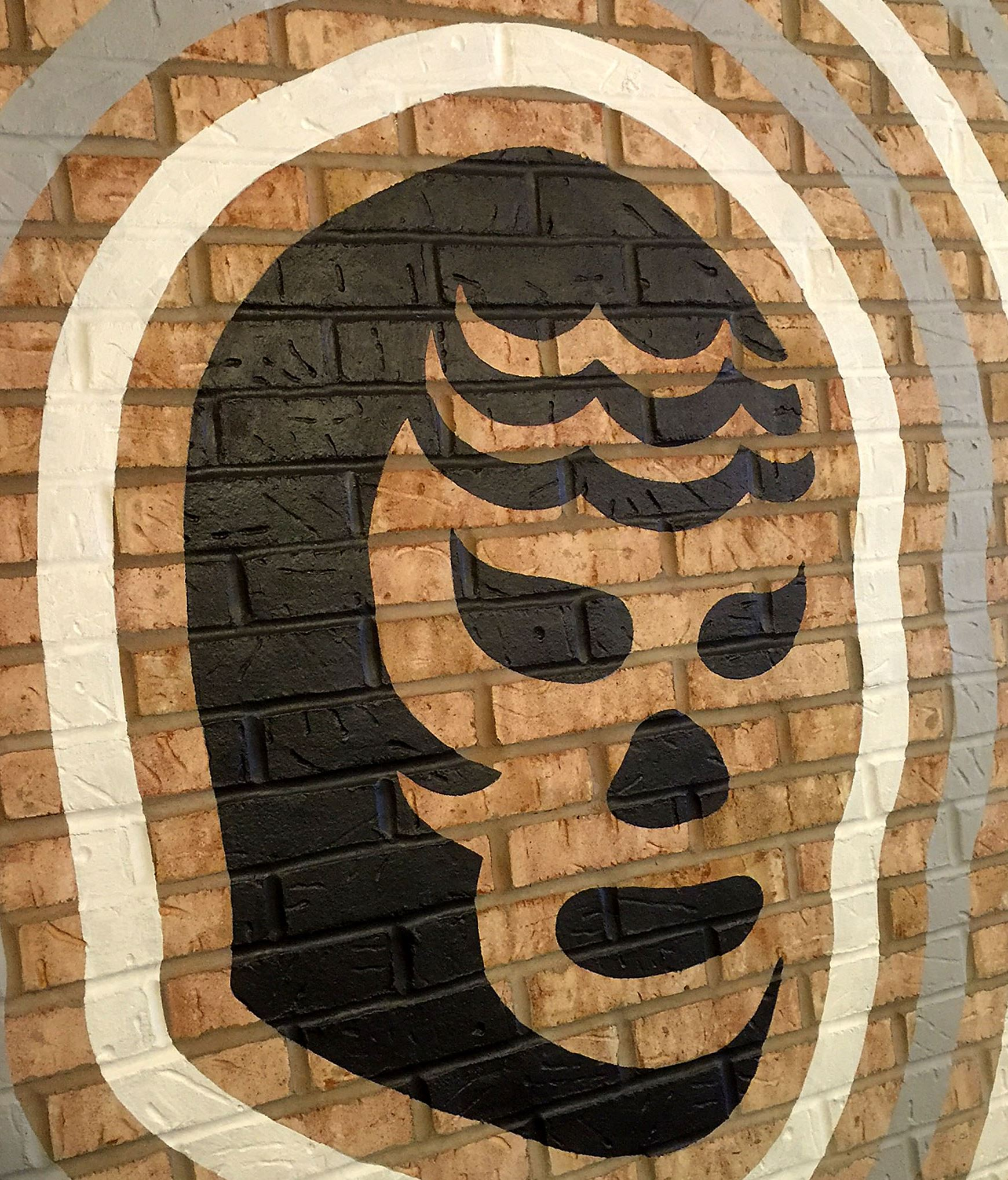 munch tres rios mask-2 A mural of a Luche Libre mask at at Tres Rios on the South Side.
