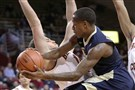 Pitt guard Justice Kithcart looks to pass as Boston College center Johncarlos Reyes defends Wednesday.