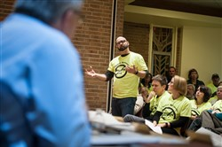 Heath Turnquist, 43, of Aspinwall voices his opposition to a development adjacent to the town's new riverside park at Aspinwall's town council meeting at St. Scholastica Pastoral Center in February.