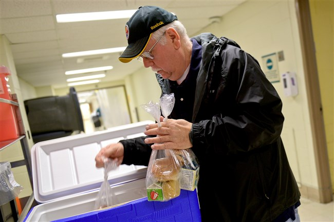 Bob Seidelson starts his day at Forbes Regional Hospital, volunteering with Meals on Wheels. Mr. Seidelson is one of hundreds of Westinghouse retirees who belong to Service Uniting Retired Employees, or SURE, a service organization for former Westinghouse workers and spouses.