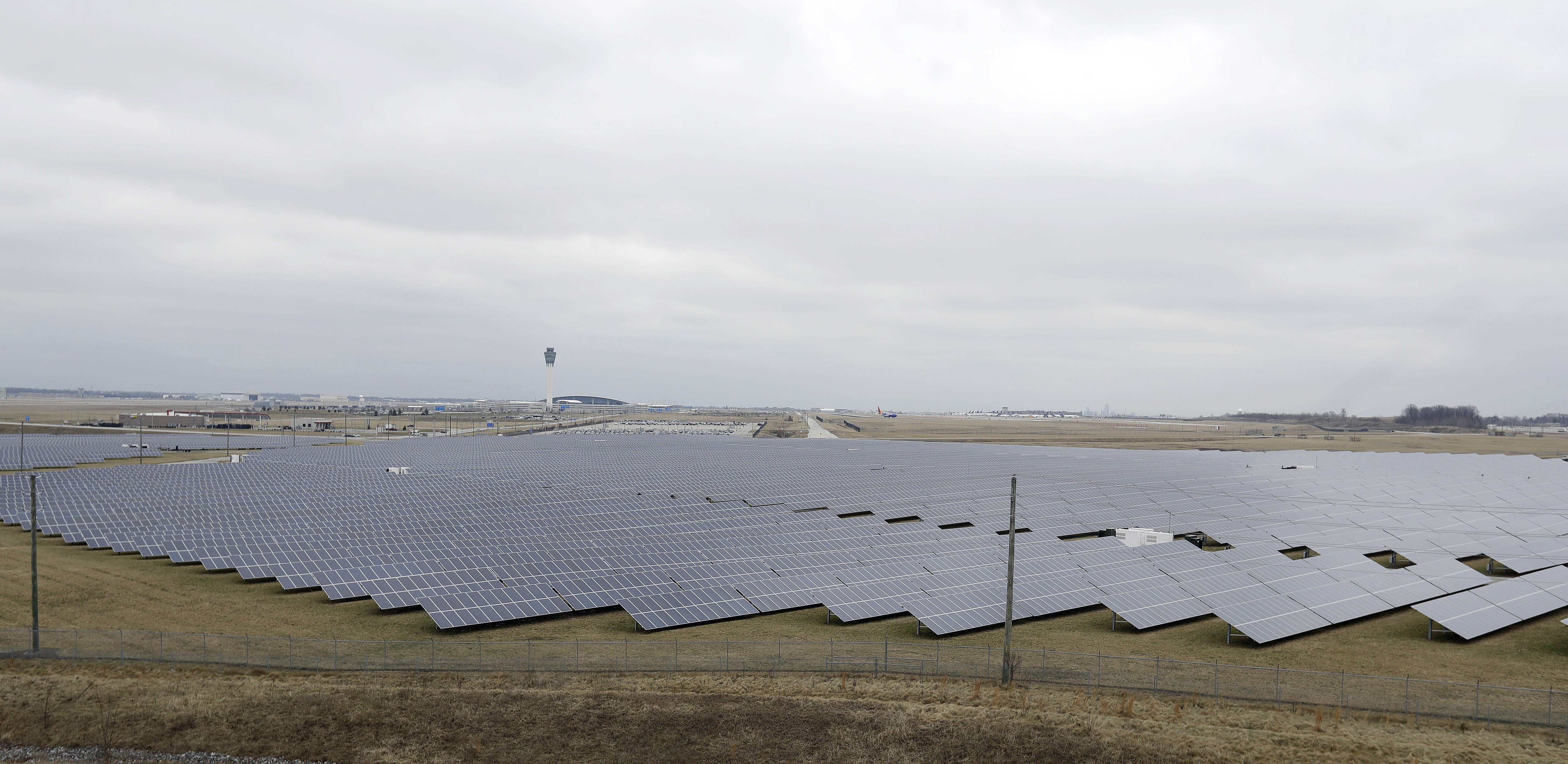 Solar Energy Indiana-1 The solar farm at the Indianapolis International Airport is pictured, Wednesday, Feb. 8, 2017, in Indianapolis. Duke Energy and other utilities are backing measures in the Indiana Legislature and several other states that would eventually end the ability of small operators to produce solar power. (AP Photo/Darron Cummings)